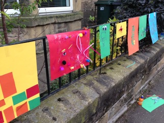 Children's art on garden railings. Photo by Mary Hutchison